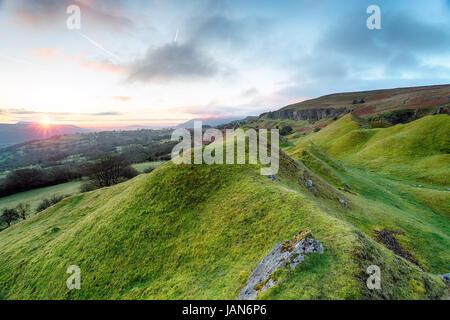 Sunrise over the Llangattock Escarpment in the Brecon Beacons in Wales - Stock Photo