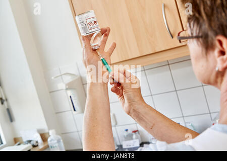 nurse preparing an injection - Stock Photo