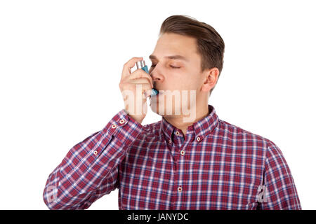 Picture of a young man having an asthma attack - Stock Photo