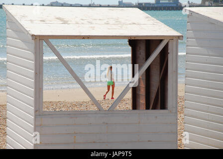 Dorset UK. 7th June, 2017. A woman enjoys strolling in the sunshine on a blustery day along Weymouth sands Credit: - Stock Photo