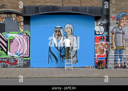 Bristol, UK. 7th June, 2017. A new piece of street art takes shape in Stokes Croft. Stokes Croft is an area of the - Stock Photo