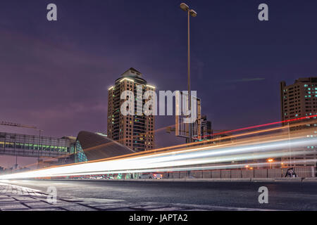 Light track of cars in a long exposure of dubai city. Internet city - Stock Photo