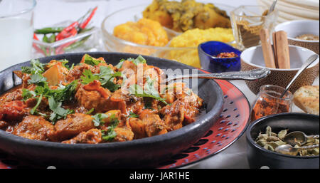 Close up view of a delicious chicken tikka masala with Indian spices - Stock Photo