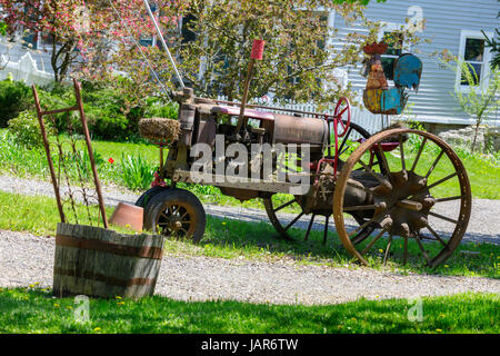 ROSEBOOM, OTSEGO COUNTY, NEW YORK – MAY 17, 2017: Antique tractor is the centerpiece of someone's lawn decoration. - Stock Photo