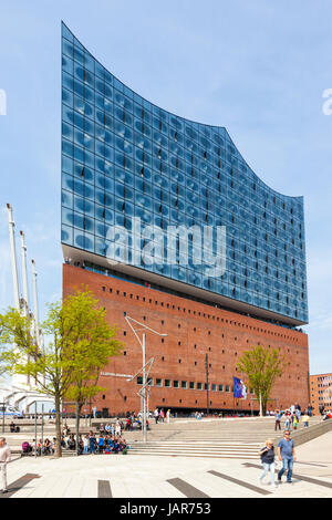 Hamburg, Germany - May 17, 2017: Entrance side of Elbphilharmonie, concert hall at Hamburg HafenCity quarter. Tourists - Stock Photo
