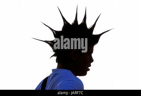 Young man with a punk style hairdo - Stock Photo