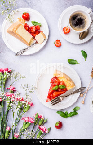 Flat lay with strawberry cheesecake - Stock Photo