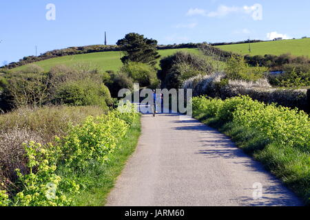 Padstow, Cornwall, UK - April 6th 2017: Family enjoying a evening cycle ride along the Camel Trail near Padstow - Stock Photo