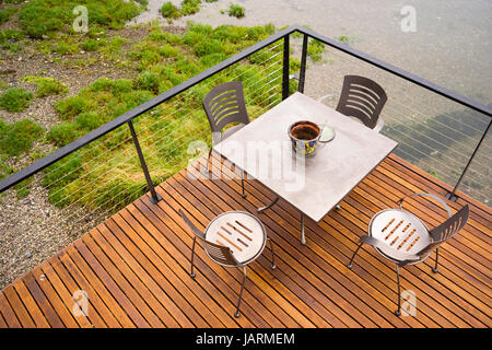Wood Plank Deck Patio Beach Water Stainless Steel Dining Set - Stock Photo
