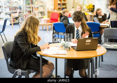 secondary school pupils using technology for learning - Stock Photo