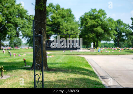 A sign in a cemetary on Memorial Day that says Last Supper, a name for an area of the cemetary. Wichita, Kansas, - Stock Photo