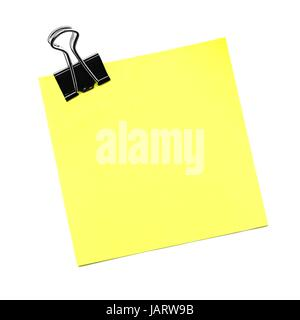 Single yellow sticky note with paper clip isolated on white - Stock Photo