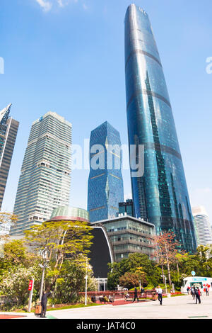 GUANGZHOU, CHINA - APRIL 1, 2017: visitors on square and towers in Zhujiang New Town of Guangzhou city in spring. - Stock Photo