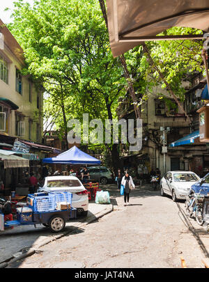 GUANGZHOU, CHINA - APRIL 1, 2017: people in yard of old residential apartment houses of Guangzhou city in spring. - Stock Photo