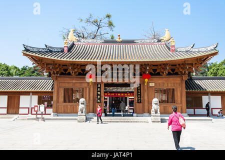 GUANGZHOU, CHINA - APRIL 1, 2017: people near entrance to Guangxiao Temple (Bright Obedience, Bright Filial Piety - Stock Photo