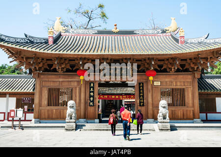 GUANGZHOU, CHINA - APRIL 1, 2017: people near doors to Guangxiao Temple (Bright Obedience, Bright Filial Piety Temple). - Stock Photo