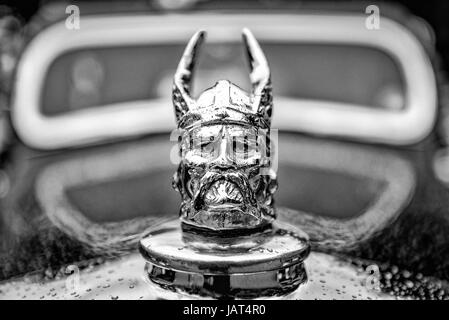 Viking head on the front of an old Rover 10. - Stock Photo