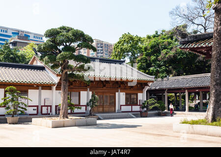 GUANGZHOU, CHINA - APRIL 1, 2017: visitors in court of Guangxiao Temple (Bright Obedience, Bright Filial Piety Temple). - Stock Photo