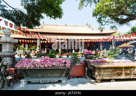 GUANGZHOU, CHINA - APRIL 1, 2017: people in court of Guangxiao Temple (Bright Obedience, Bright Filial Piety Temple). - Stock Photo