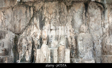 LUOYANG, CHINA - MARCH 20, 2017: carved Buddha figure in Longmen Grottoes (Longmen Caves). The complex was inscribed - Stock Photo