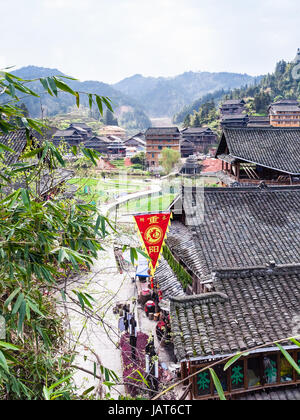 CHENGYANG, CHINA - MARCH 27, 2017: above view of shopping street in Chengyang village of Sanjiang Dong Autonomous - Stock Photo