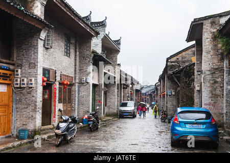 XINGPING, CHINA - MARCH 30, 2017: people on typical street in Xing Ping town in Yangshuo county in spring. The town - Stock Photo