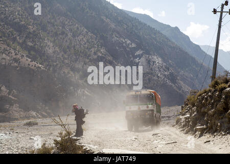 Truck and people on dust road - Stock Photo