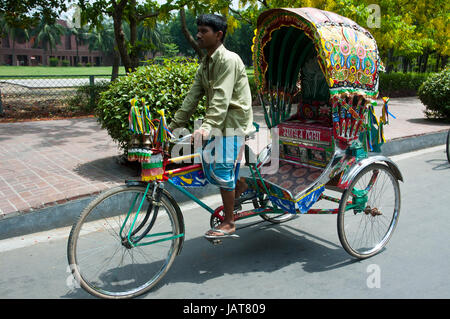 Rickshaw, a traditional transport in the urban as well as rural areas of Bangladesh. Dhaka, Bangladesh. - Stock Photo
