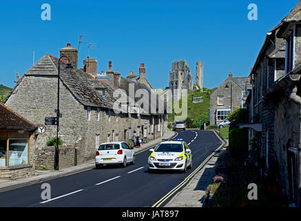 Police car on A351 in Corfe Castle, Dorset, England UK - Stock Photo