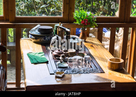 travel to China - empty dish on table in chinese restaurant in Chengyang village of Sanjiang Dong Autonomous County - Stock Photo