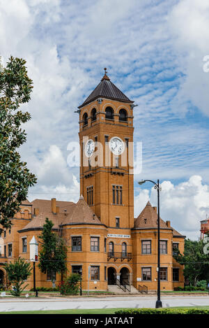 The old Macon County Courthouse located in Tuskegee Alabama, USA.  Made of traditional red brick found in many buildings - Stock Photo