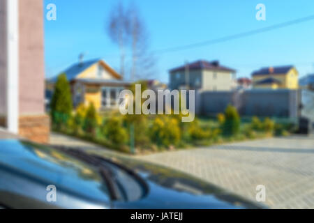 Blured view on yard of a private house. Abstract blur background - Stock Photo
