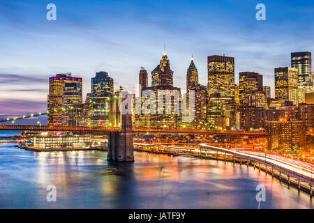 New York City skyline with the Brooklyn Bridge and Financial district on the East River. - Stock Photo