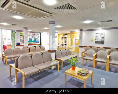 Empty waiting room in large NHS hospital.  A quiet space without any patients - Stock Photo