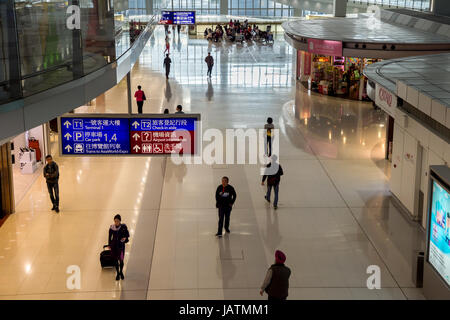 Hong Kong, China, 28th February 2015. Passengers walking in Hong-Kong Chek Lap Kok Airport. - Stock Photo