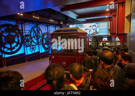 Tourists queueing for the Peak Tram, Victoria Peak, Hong Kong Island, Hong Kong, China - Stock Photo