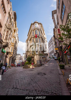 ISTANBUL, TURKEY – APRIL 27: Building with flag and pedestrians on April 27, 2012 in Istanbul, Turkey.  Each year - Stock Photo