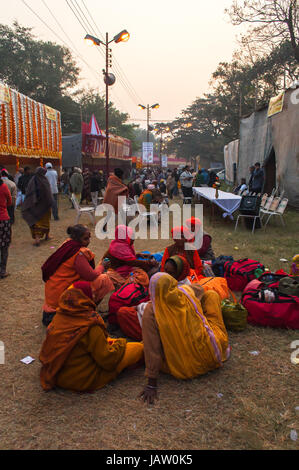 BABUGHAT, KOLKATA, WEST BENGAL / INDIA - 9TH JANUARY 2013 : Female devotees gossiping  on 9th January, 2013 at Babughat, - Stock Photo