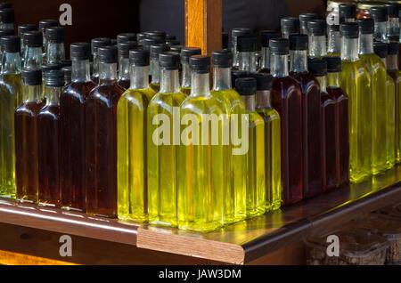 Bottles of raki on a stand along a Crete's road - Stock Photo
