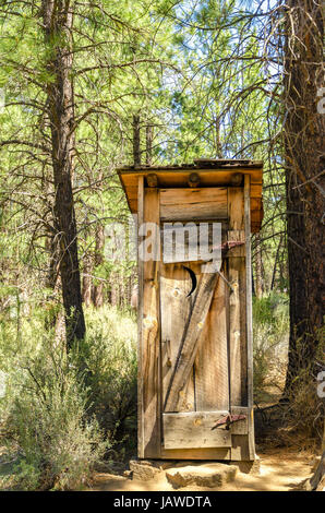 Old fashioned antique outhouse toilet restroom two seater for Reclaimed wood bend oregon