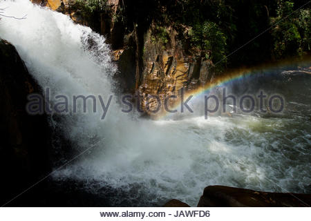 Rainbow in the mist of Riam Berasap, the Falls of the Mists, which is the largest waterfall in Gunung Palung National - Stock Photo