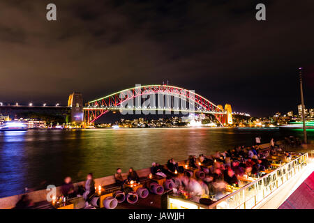 The Sydney Harbour Bridge coloured red during Vivid Sydney Light, Music and Ideas Festival. - Stock Photo
