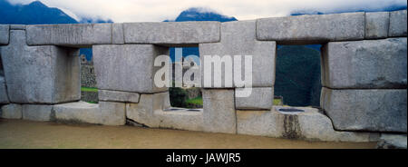The Temple of the Three windows is a sacred structure in the Inca ruins at Macchu Picchu. - Stock Photo
