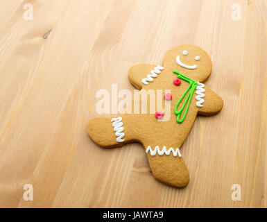 Gingerbread man on wooden background - Stock Photo