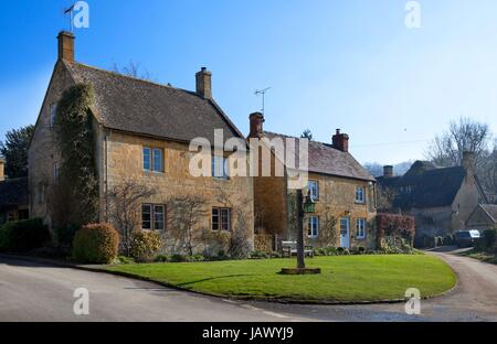 Two Cotswold houses in the Gloucestershire village of Stanton, England. - Stock Photo