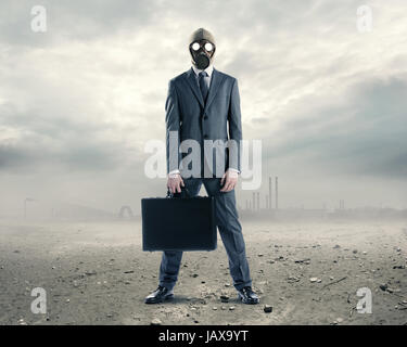 pollution concept: portrait of businessman in a gas mask  with suitcase - Stock Photo