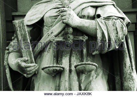 justitia holding the scales of justice as a symbol  of equality before the law - Stock Photo