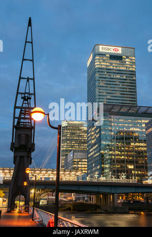 London, United Kingdom - May 9, 2011: HSBC's world Head Quarters building and old port cranes at Canary Wharf. It - Stock Photo