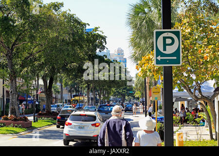 FORT LAUDERDALE, FLORIDA - FEBRUARY 3, 2013: Adult pedestrians shopping, walking and dining near downtown in a trendy - Stock Photo
