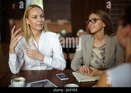 Conducting Negotiations with Business Partners - Stock Photo